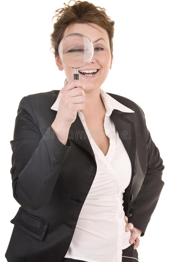 Businesswoman Looking Into A Magniying Glass stock photography