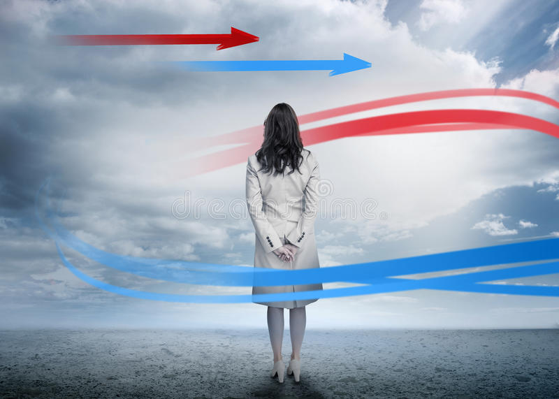Download Businesswoman Looking At Red And Blue Arrow Stock Image - Image: 33215073