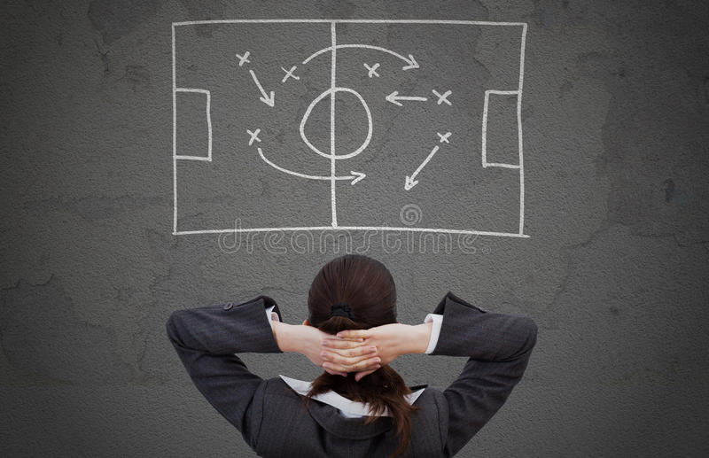 Businesswoman looking at strategically game plan royalty free stock images