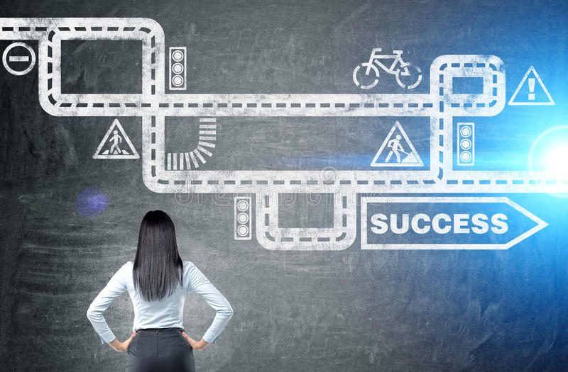 Businesswoman looking at success sketch. Businesswoman looking at road to success sketch on chalkboard background stock photo