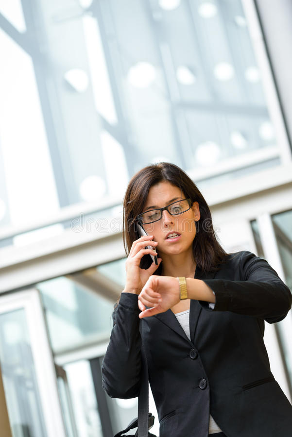 Businesswoman looking time in watch royalty free stock images