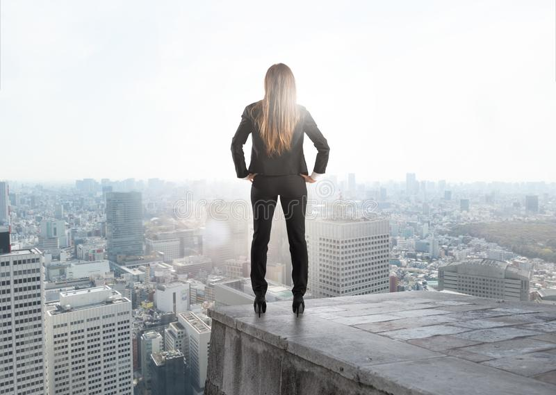 Businesswoman looking to the future for new business opportunity. stock image