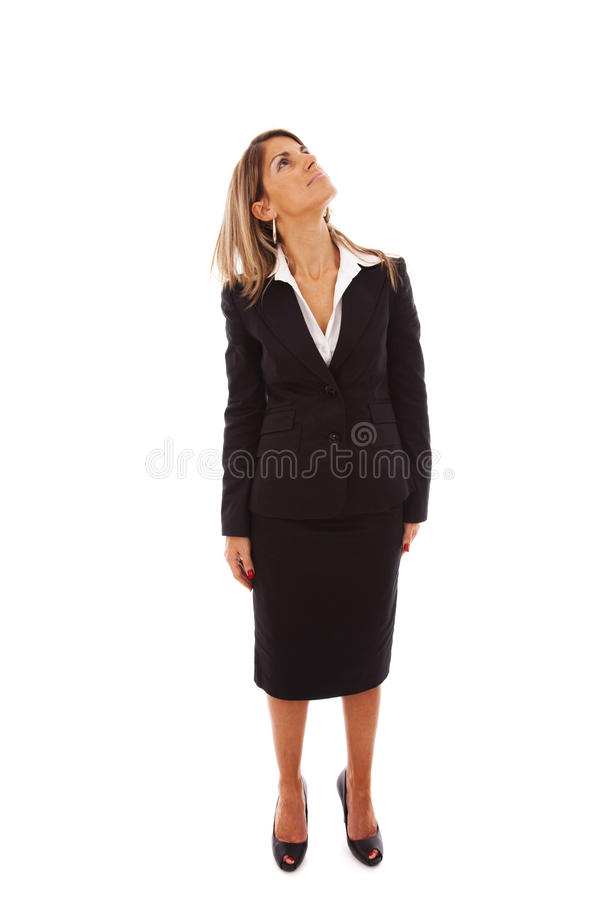 Businesswoman looking up stock photo