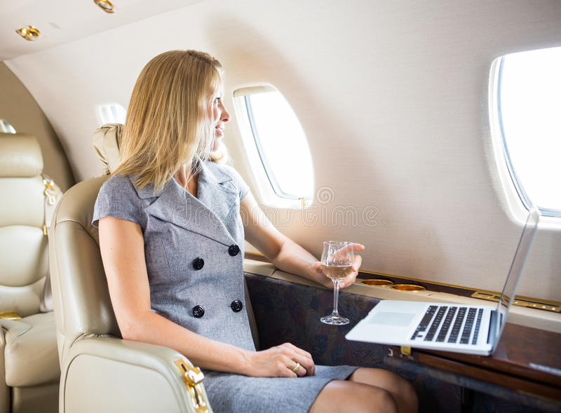 Businesswoman Looking Through Window Of Private royalty free stock photography