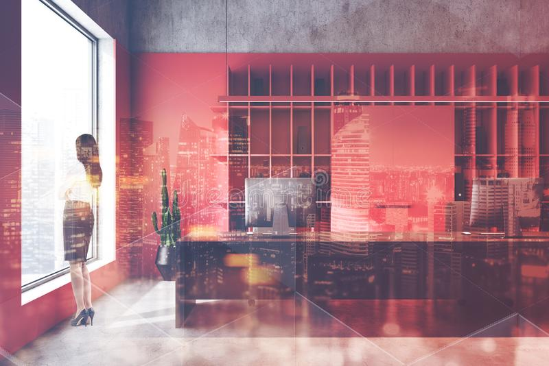 Businesswoman in luxury red office. Young businesswoman standing in luxury loft office with red and concrete walls, long computer table and double exposure of royalty free stock photo