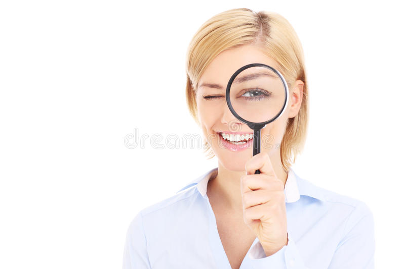 Businesswoman and magnifier royalty free stock images