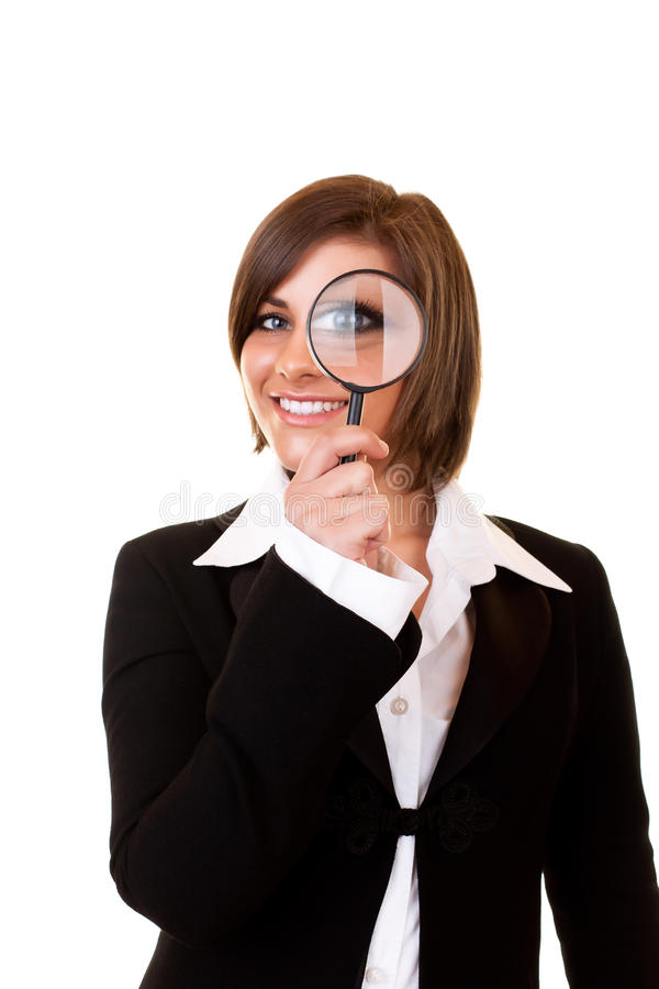 Businesswoman and magnifying glass royalty free stock photo