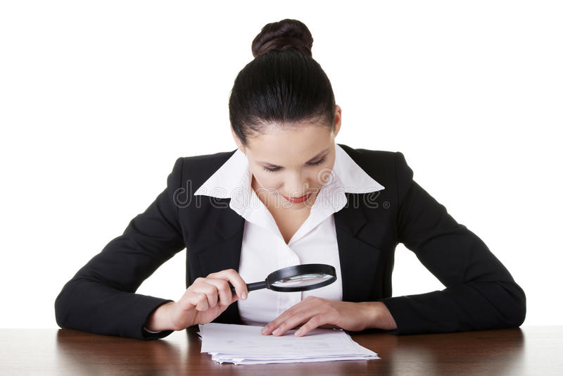Businesswoman with magnifying glass royalty free stock photo