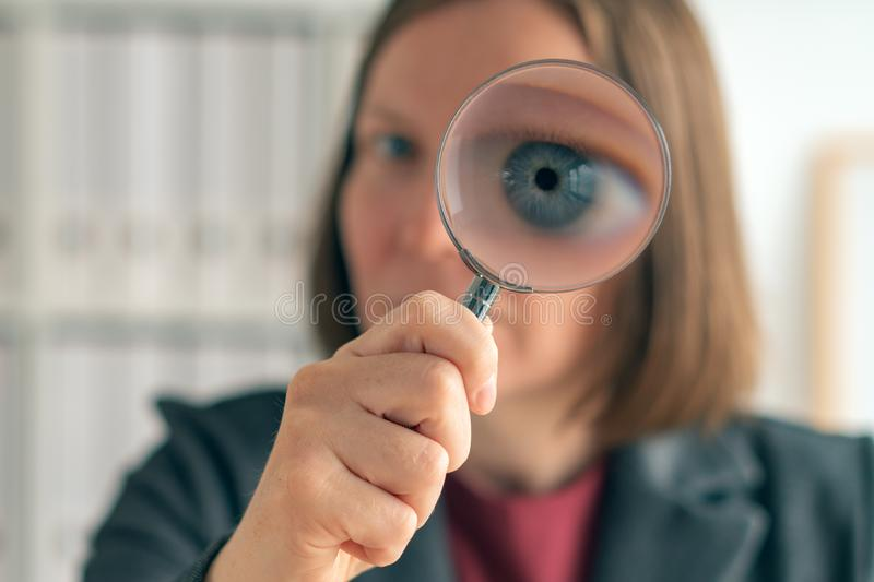 Businesswoman with magnifying glass doing business financial auditing stock image