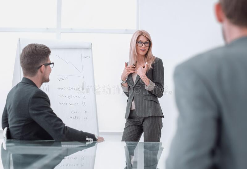 Businesswoman makes a presentation of the new project royalty free stock photo