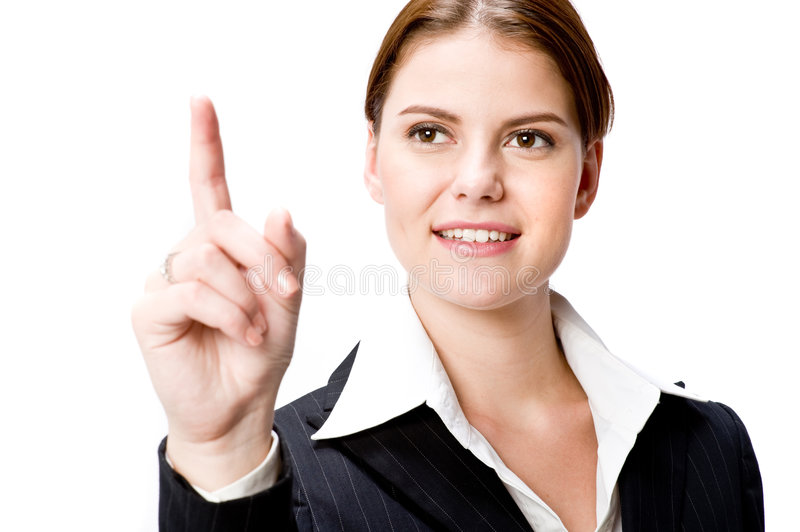 Businesswoman making choice. A young attractive businesswoman makes a point or selection with her index finger raised in the air on white background stock photos