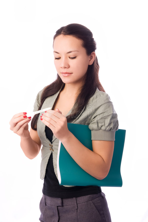 Businesswoman making manicure at work royalty free stock images