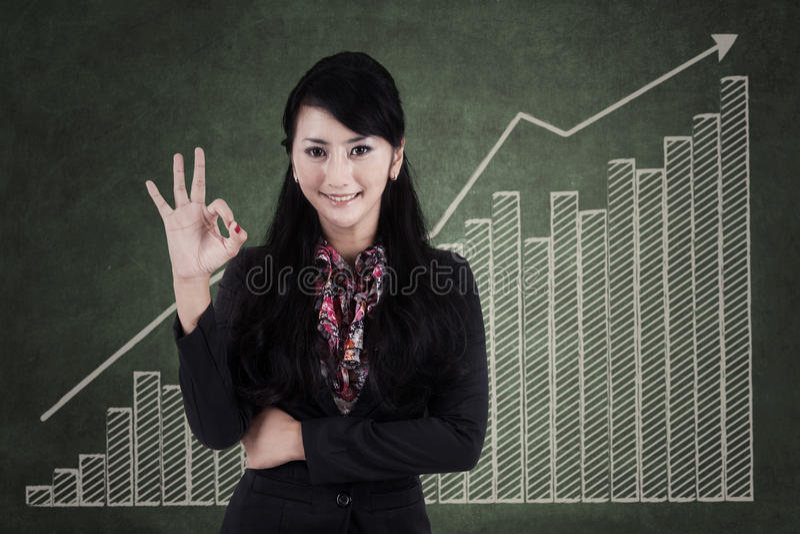 Businesswoman making an ok sign 1 stock photos