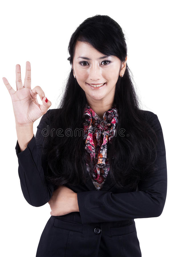 Businesswoman making an ok sign stock images