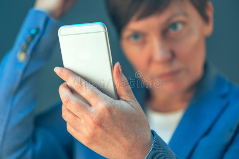 Businesswoman making selfie photo portrait with mobile phone stock photo