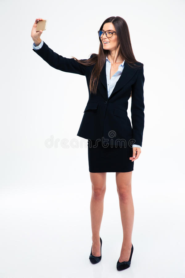 Businesswoman making selfie photo on smartphone royalty free stock photography