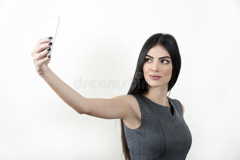 Businesswoman making selfie photo on smartphone royalty free stock images