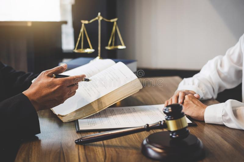 Businesswoman and Male lawyer or judge consult having team meeting with client, Law and Legal services concept stock image