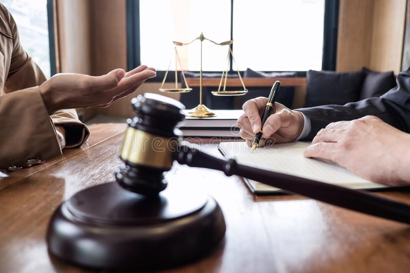 Businesswoman and Male lawyer or judge consult having team meeting with client, Law and Legal services concept stock photos