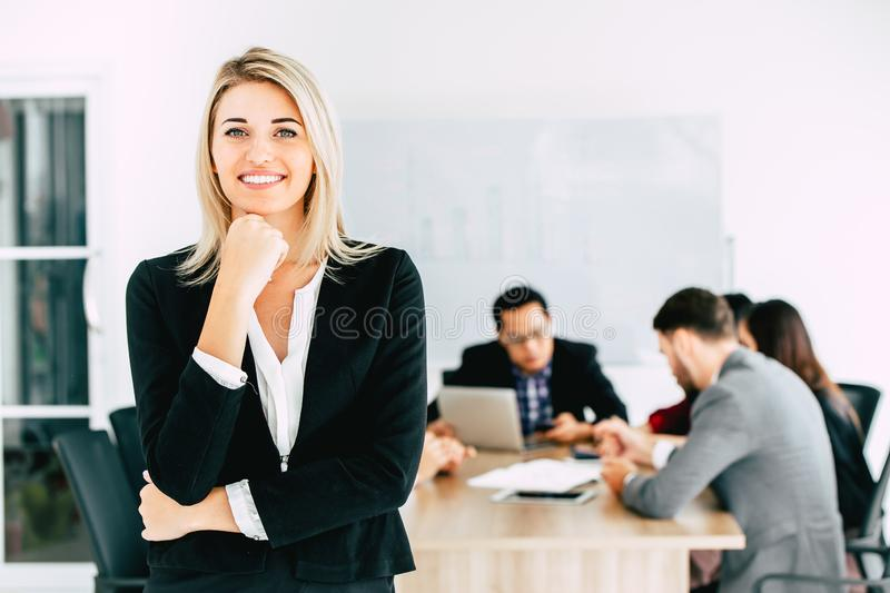 Businesswoman manager standing smile with business team working together stock photography