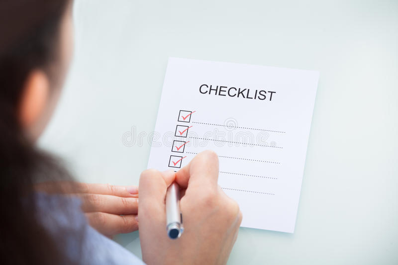 Businesswoman marking on checklist royalty free stock images
