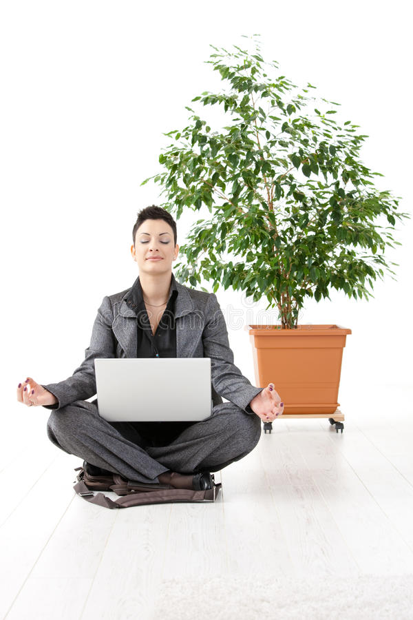Download Businesswoman meditating stock image. Image of attire - 11396163