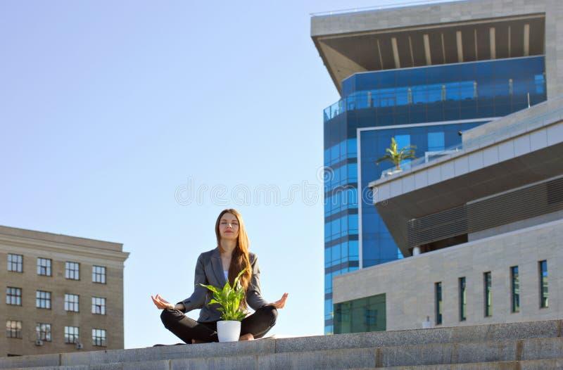 Businesswoman meditating stock photography