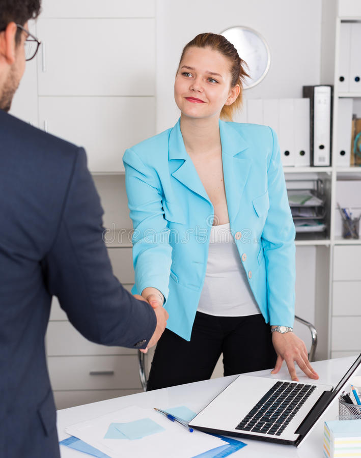 Businesswoman meetings male colleague royalty free stock photography