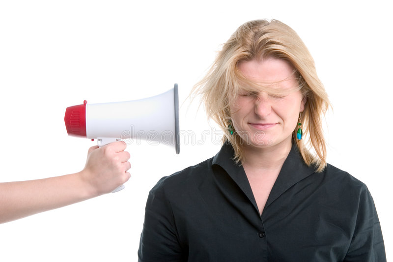 Businesswoman with megaphone held to her head stock images
