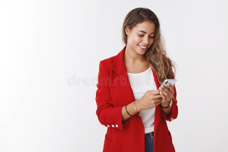 Businesswoman messaging partner grab take-away coffee near office typing smartphone display, holding mobile phone stock images