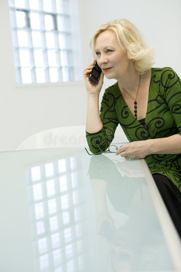 Download Businesswoman with mobile stock photo. Image of authoritative - 5620864