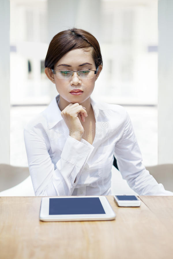 Businesswoman With Mobile Devices Royalty Free Stock Photography