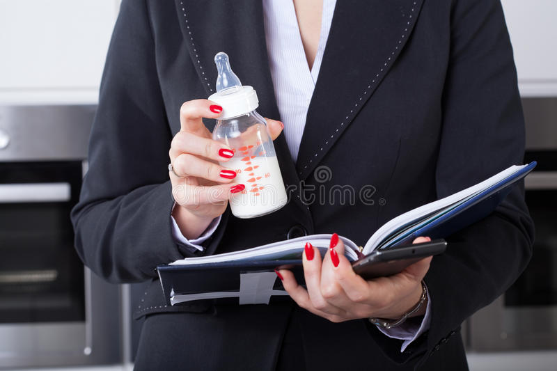 Businesswoman or mom royalty free stock image