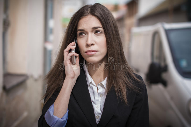 Businesswoman at monday morning. Unhappy businesswoman at monday morning calling stock photo