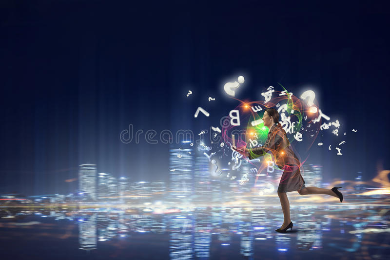 Businesswoman on the move royalty free stock photography