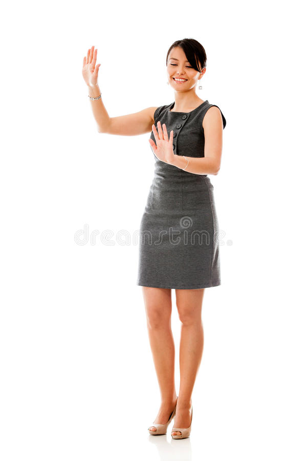 Businesswoman moving imaginary objects