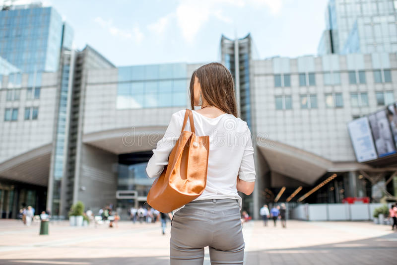 Businesswoman near the parliament building in Brussel stock photos