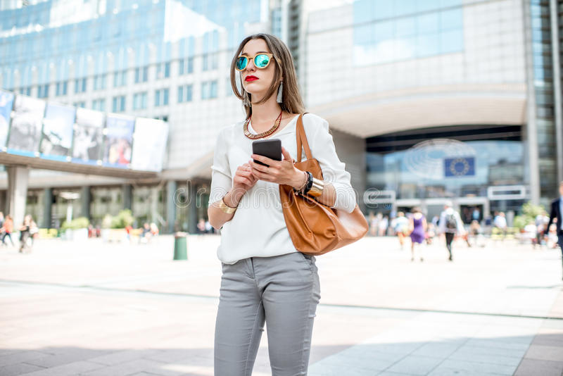 Businesswoman near the parliament building in Brussel stock photo