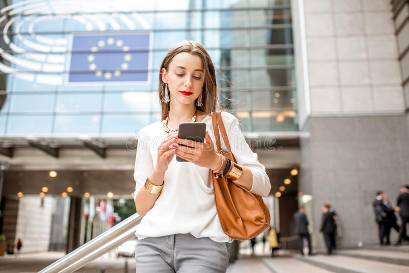 Businesswoman near the parliament building in Brussel royalty free stock images