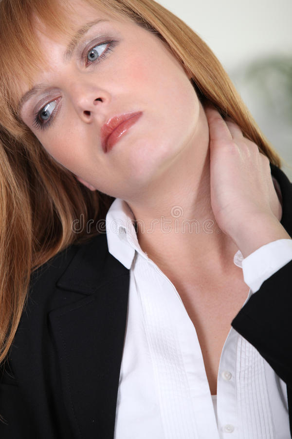 Businesswoman with neckache stock images