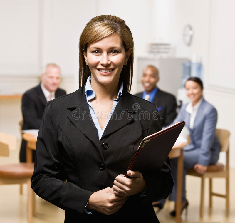 Download Businesswoman With Notebook And Co-workers Stock Image - Image of book, meeting: 6603197