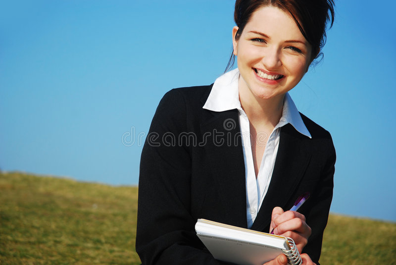 Businesswoman With Notepad Stock Image