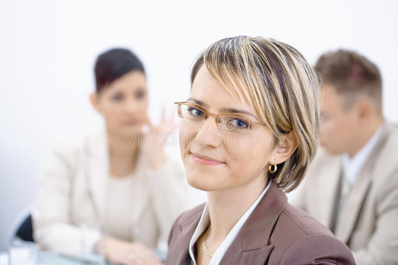 Businesswoman in office. Portrait of young businesswoman in office. Business people working in background stock photos