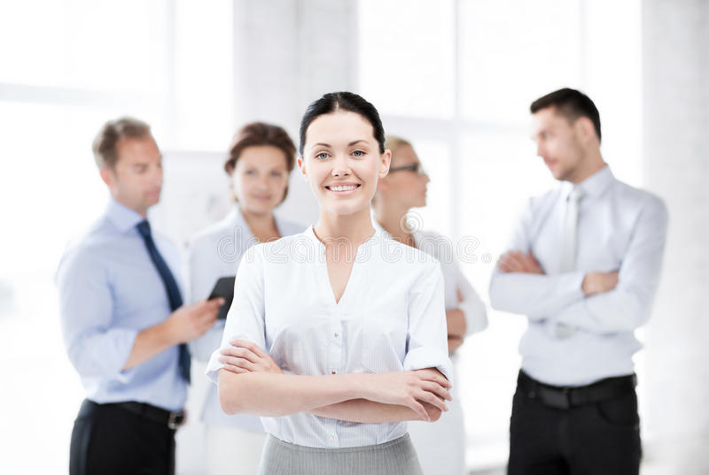 Businesswoman in office. Business concept - picture of smiling attractive businesswoman in office royalty free stock images