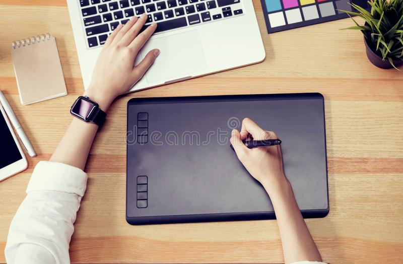 Businesswoman in office in casual shirt. Use computer for graphic designer. stock photo