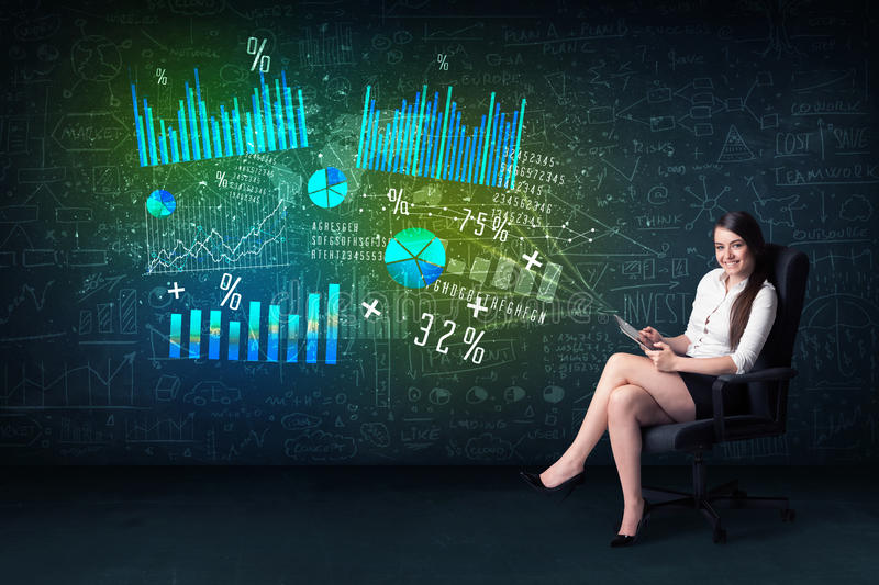 Businesswoman in office with tablet in hand and high tech graph royalty free stock image