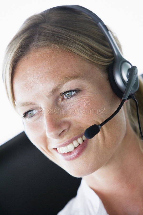 Businesswoman in office wearing headset