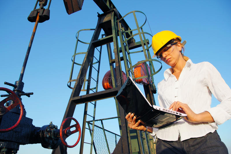 Businesswoman in an oilfield stock photos