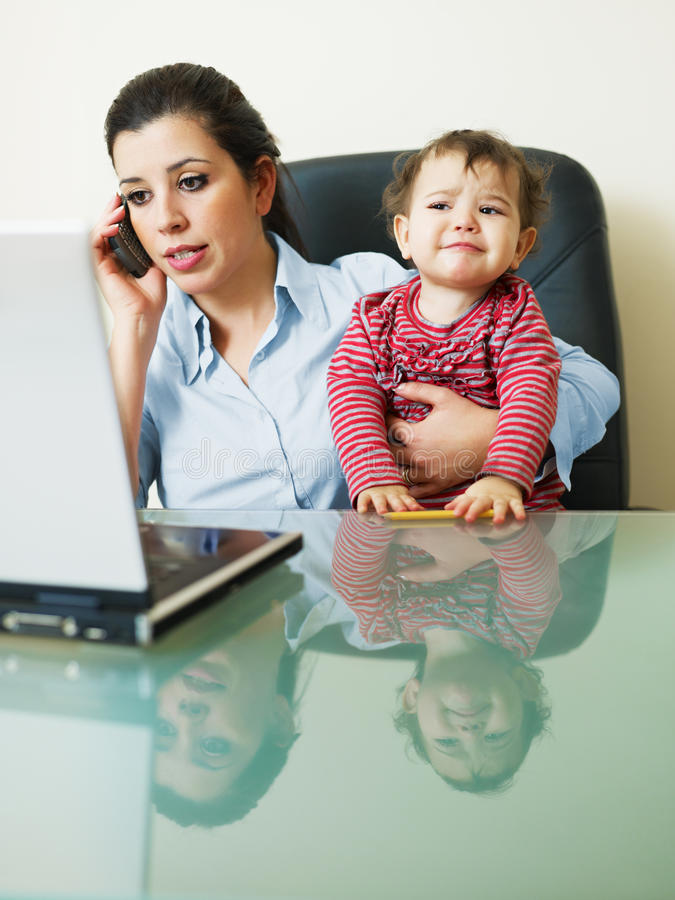 Free Businesswoman On The Phone, Holding Daughter Royalty Free Stock Image - 13017866