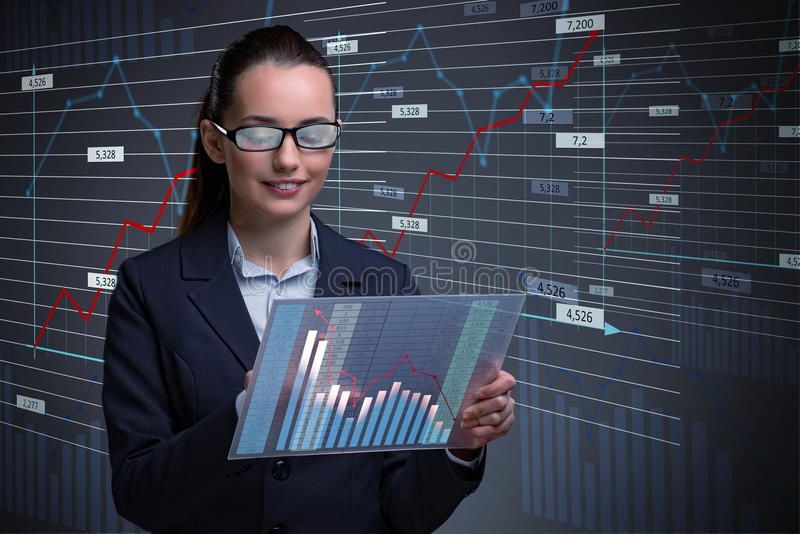 The businesswoman in online stock trading business concept. Businesswoman in online stock trading business concept royalty free stock photos